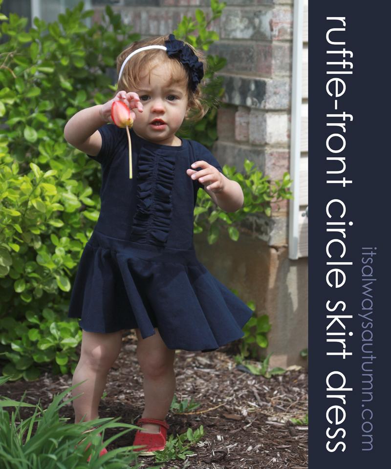 A little girl wearing a ruffle front circle skirt dress