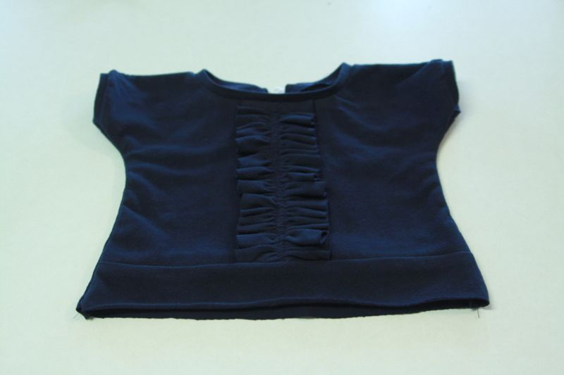 dress top front and back sewn together with neckline finished
