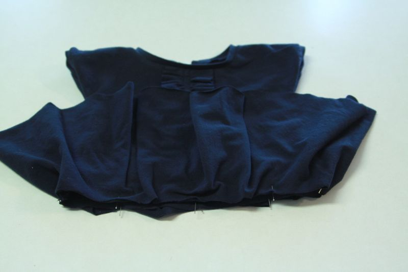 skirt placed over top and pinned together at waistline