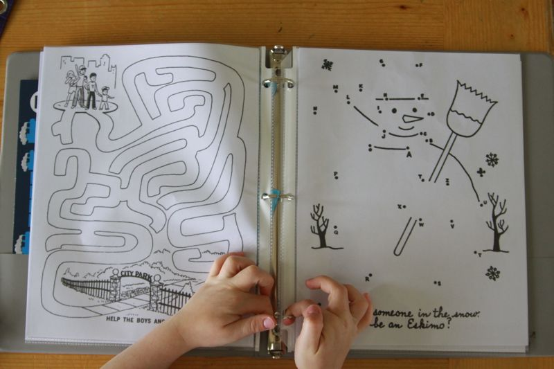 Maze and dot to dot pages in a binder