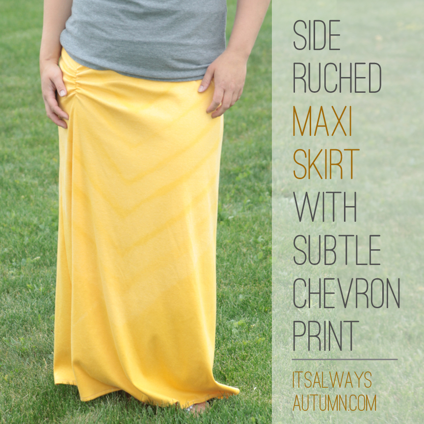 Woman wearing a side ruched maxi skirt with subtle chevron print