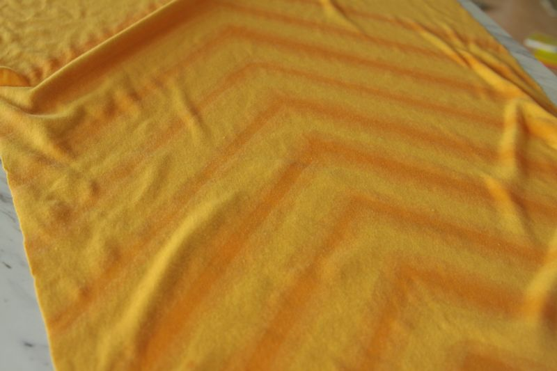 yellow fabric with chevron print made from bleach