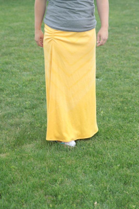 woman wearing yellow maxi skirt
