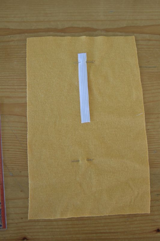 Elastic strip pinned to yellow fabric at top pin