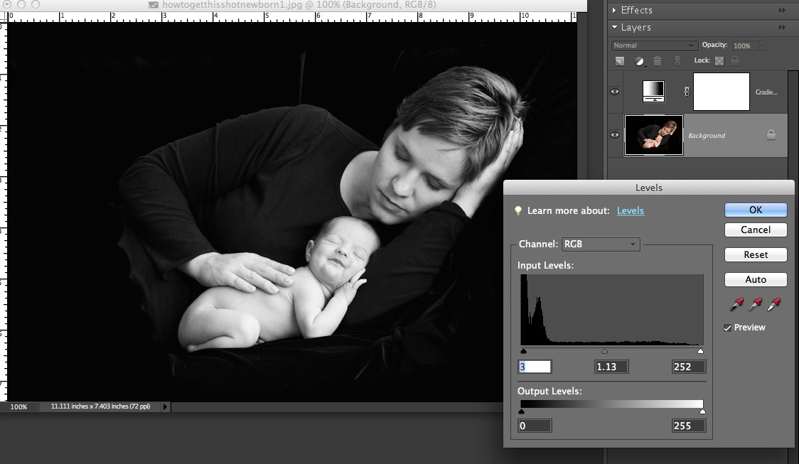 black and white photo of mom and baby open in photoshop elements with levels box open