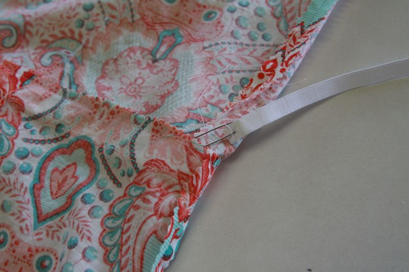 Using safety pin to thread elastic through casing