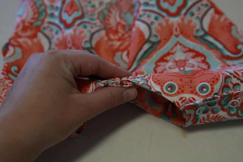 Pleat sewn into the front neckline of the runway shortie romper