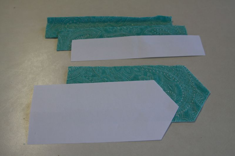 bow pieces cut from turquoise fabric