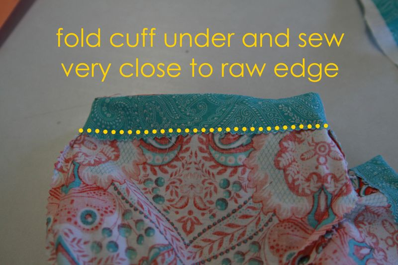 Cuff folded to the inside of the short. sew very close to raw edge