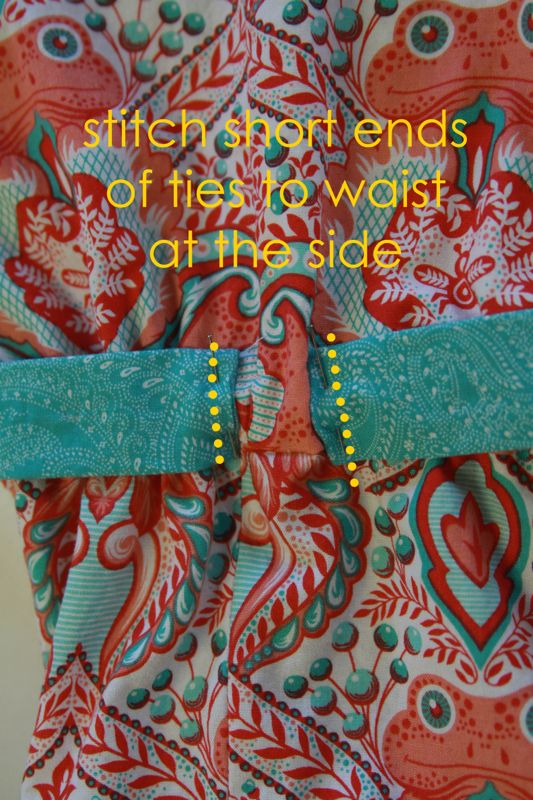 Short ends of ties stitched to romper at side waist