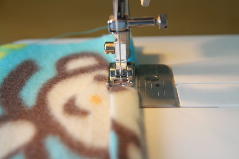 Turning up a hem and sewing on a sewing machine