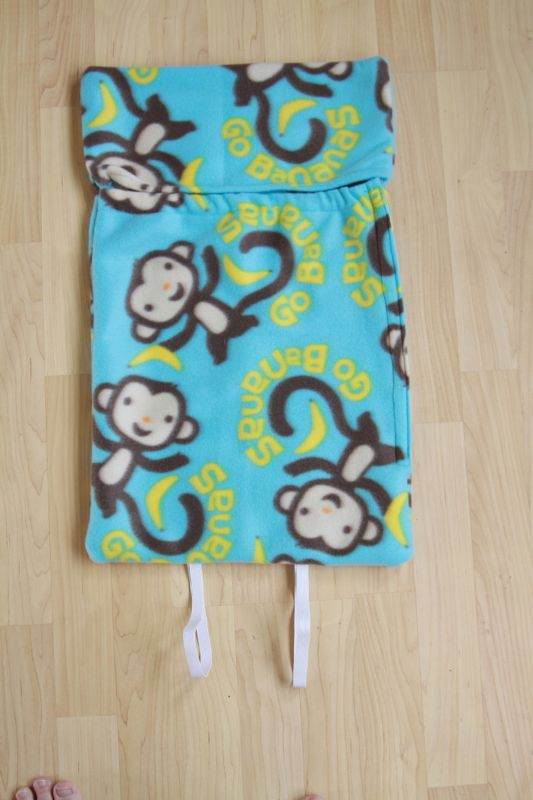 Sleeping bag sewn together, with elastic loops at the bottom and velcro along one side