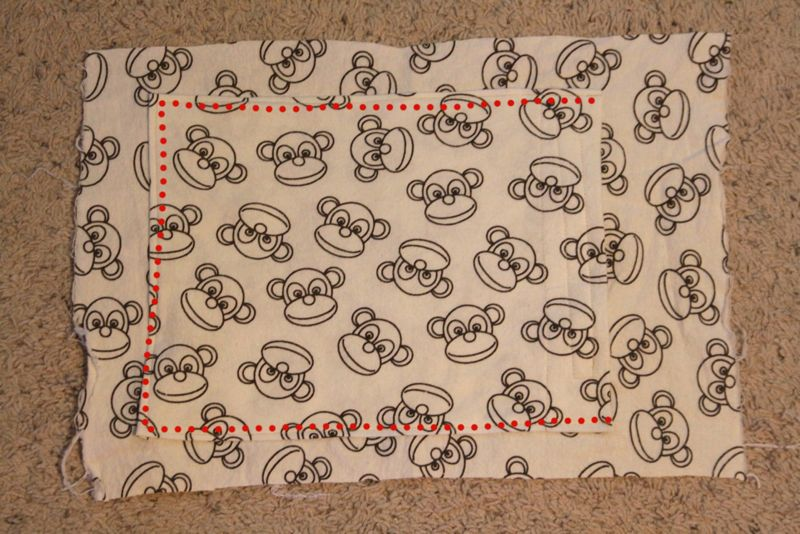 Pocket on front piece of fabric pillow case, dots marking seams to sew it on