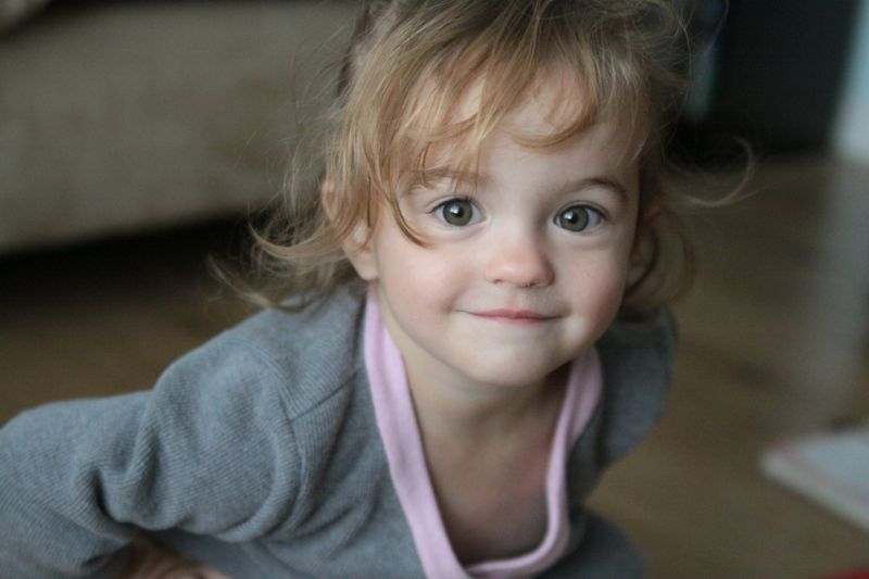 A little girl smiling at the camera