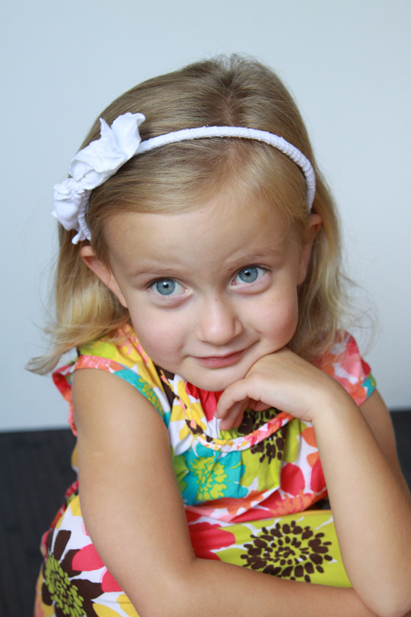 A toddler girl not looking at the camera
