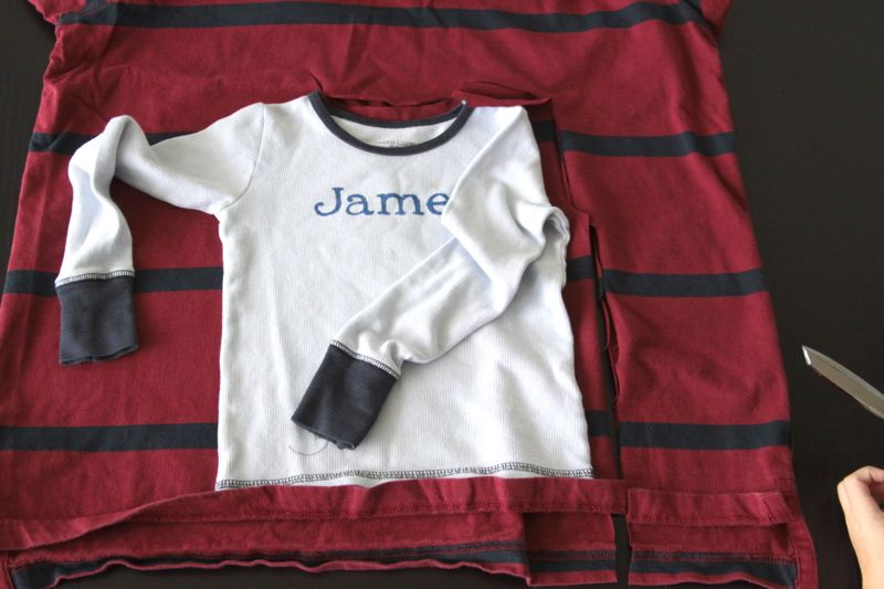pajama top laid over mens XXL t-shirt to use as a pattern