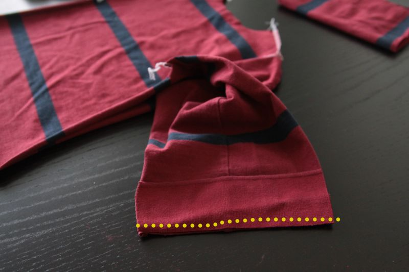 piece of shirt collar laid over end of pajama top sleeve and seam marked
