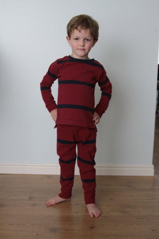 A little boy that is wearing DIY pajamas