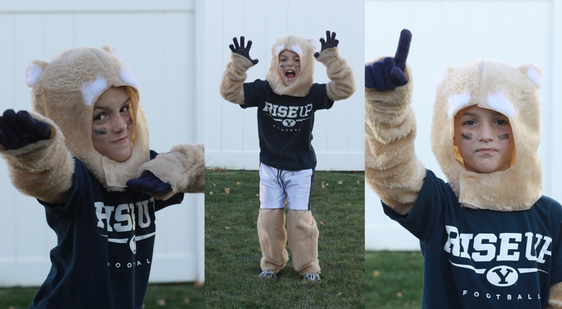 Little boy playing in a Cosmo cougar football mascot costume