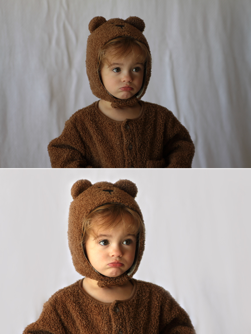 A little girl in a bear costume in front of a wrinkled background; same photo with a smooth background