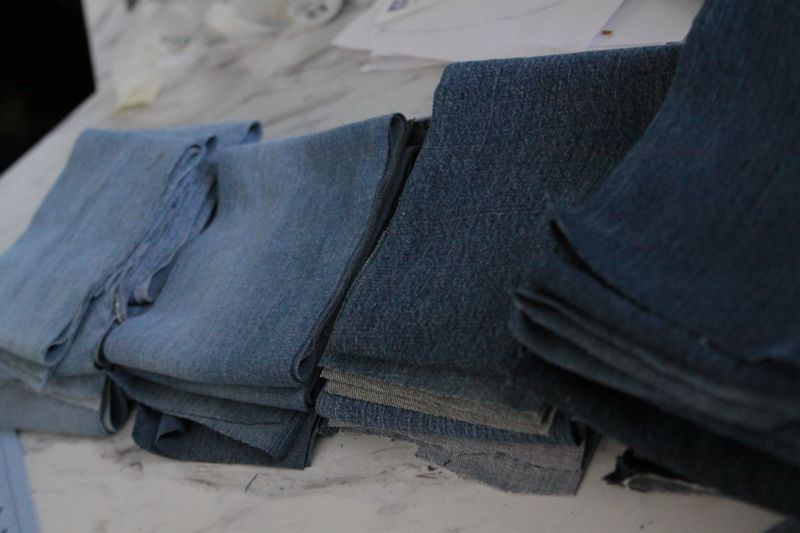 Stack of rectangles from jeans fabric, sorted by color