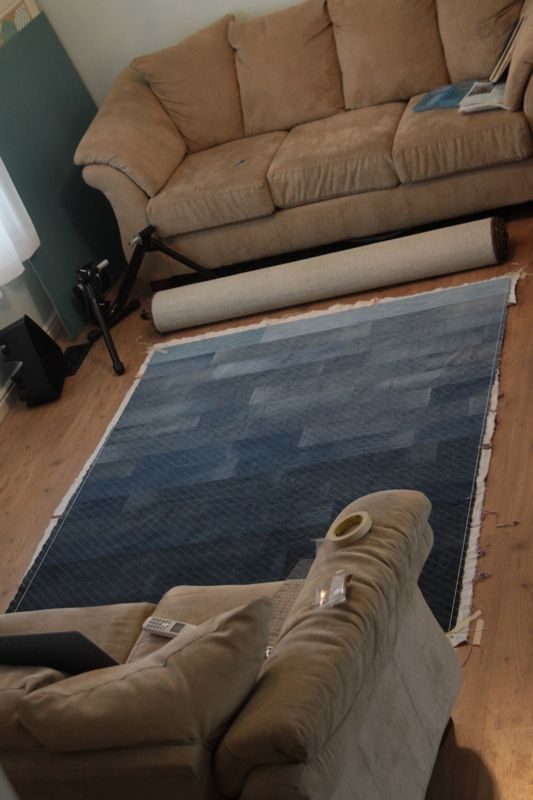 Denim quilt top laid out on the ground