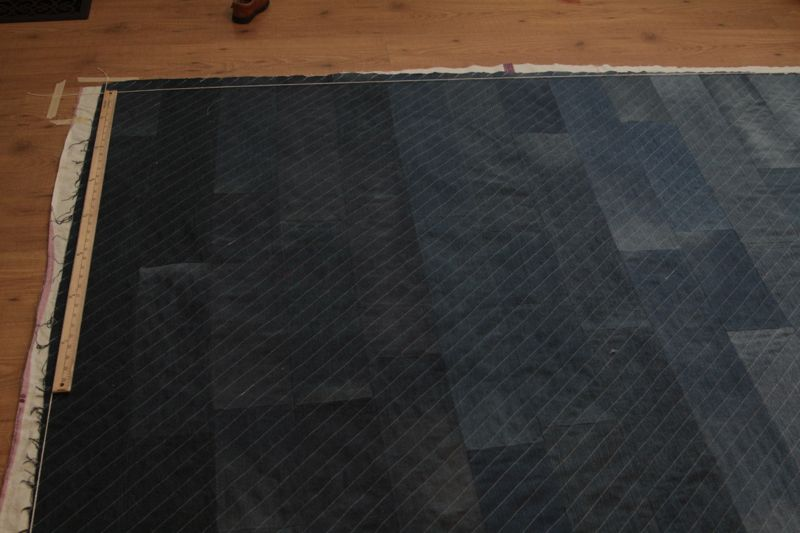 Denim quilt with diagonal quilted lines, laid out to trim edges square