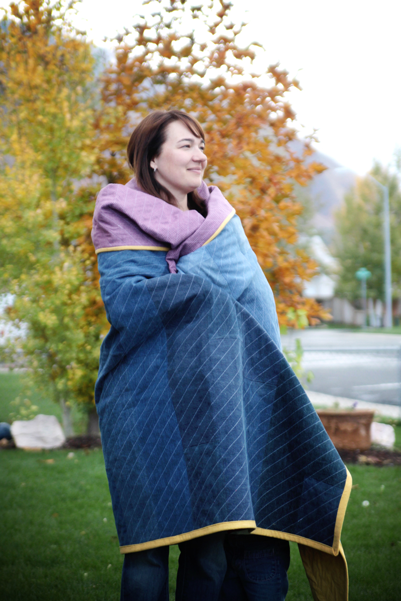A person wrapped in a DIY jeans quilt