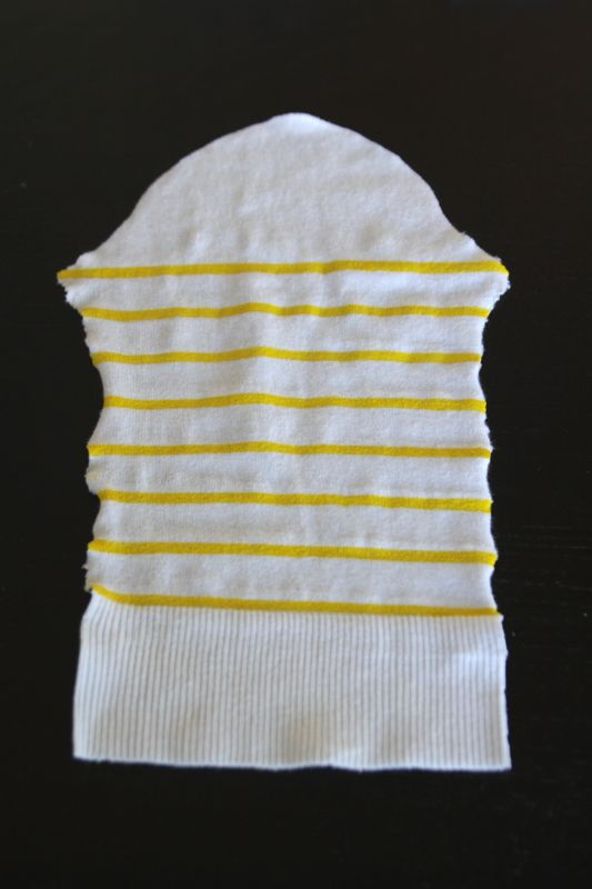 Sweater sleeve with yellow stripes