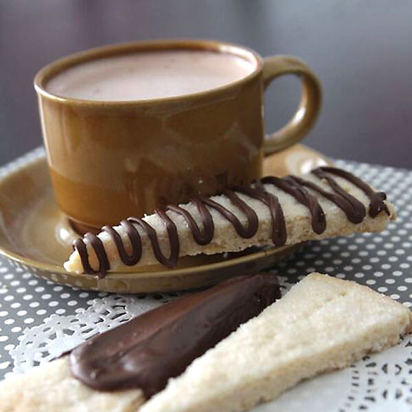 A cup of cocoa on a table, with Shortbread slices