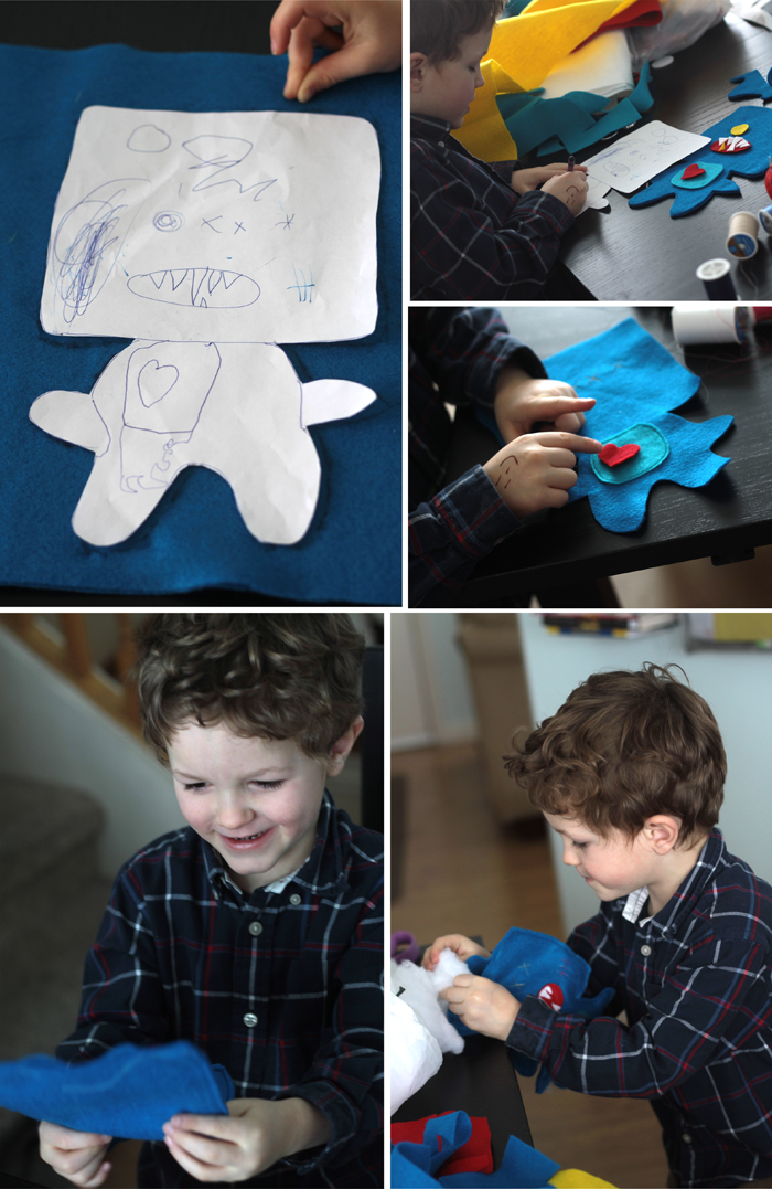 Little boy making a felt monster
