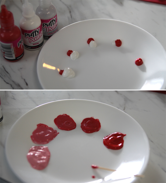 A close up paint on a plate in different shades of red and pink