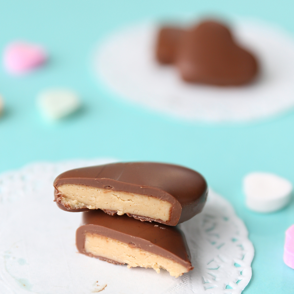 Peanut butter and chocolate heart cut in half and stacked on a doily