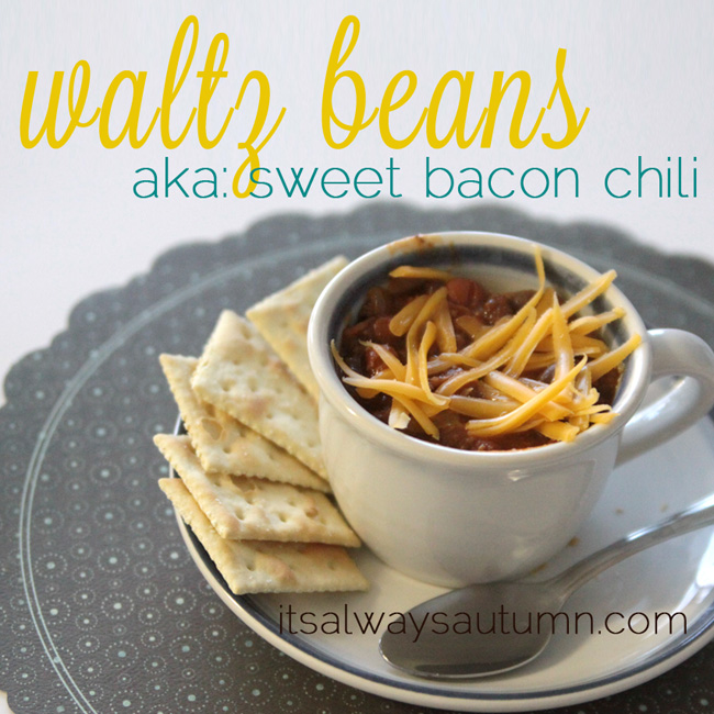 waltz beans aka sweet bacon chili in a tea cup with grated cheese on top