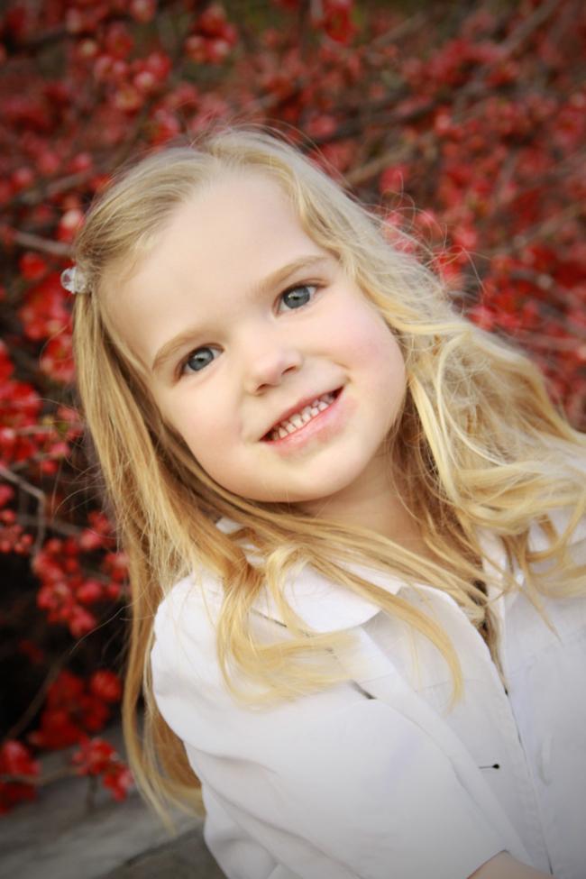 A toddler smiling at the camera