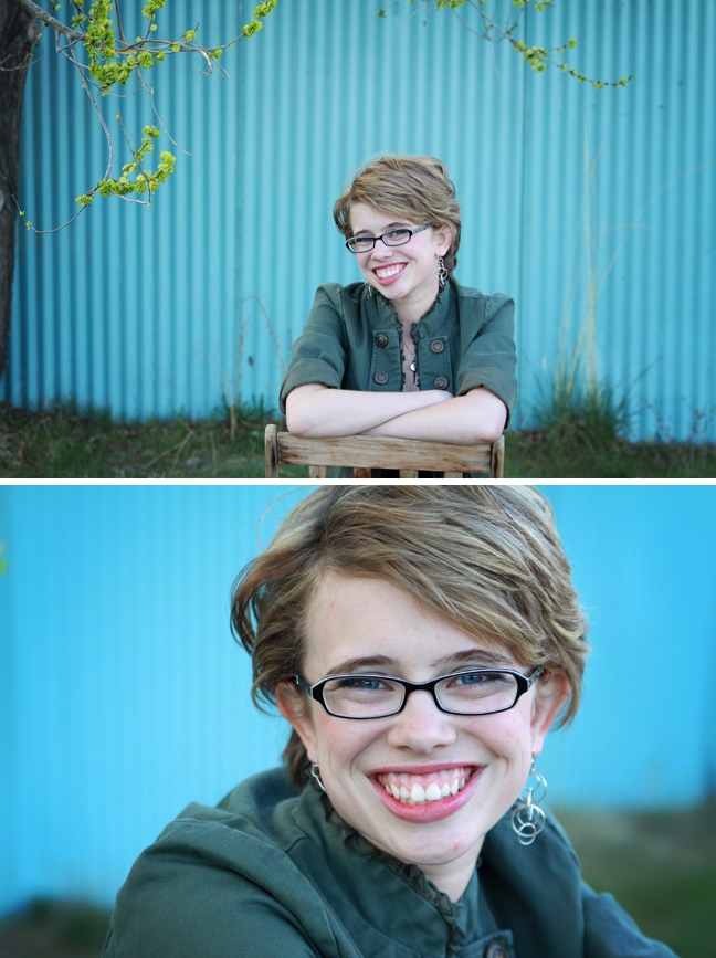 photos of a girl sitting in front of a blue corrugated wall