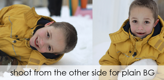 photo of boy playing in snow with distractions in the background; photo taken from different angle so there\'s only snow in the background