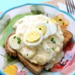Hard boiled eggs in a creamy white sauce over toast