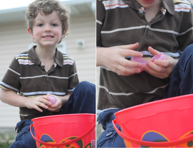A little boy smiling with Easter basket, close up of boy\'s hands opening an Easter egg