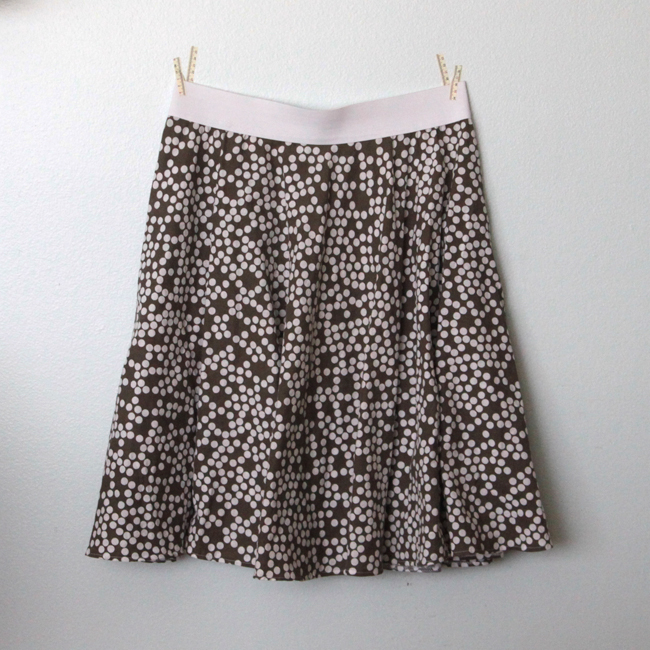 A circle skirt hanging on a wall