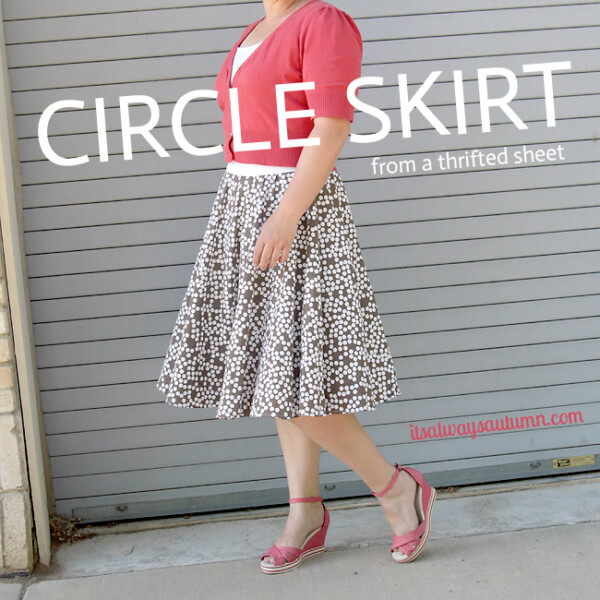 A woman standing in front of a building wearing a circle skirt made from a thrifted sheet