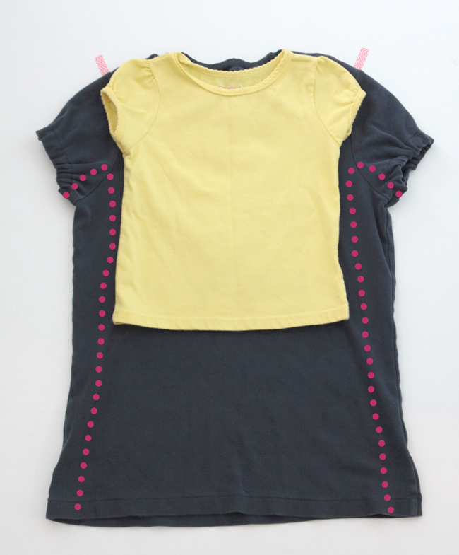 girl\'s shirt layered over the larger blue t-shirt, new side seams marked