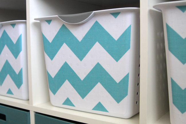 A close up of a storage bin that\'s been covered with fabric