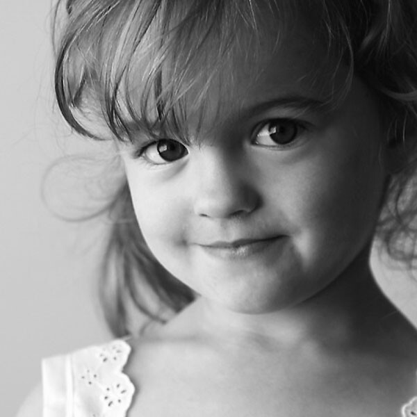 black and white photo of a young girl smiling