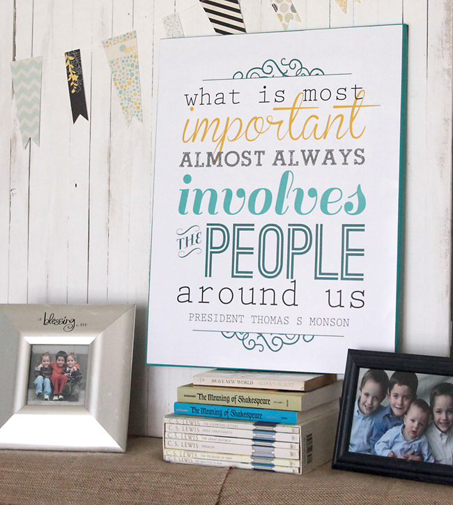 Printable quote sign on a stack of books with family photos