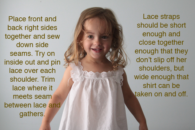 A little girl in a white lace blouse, fitting lace straps over the shoulders