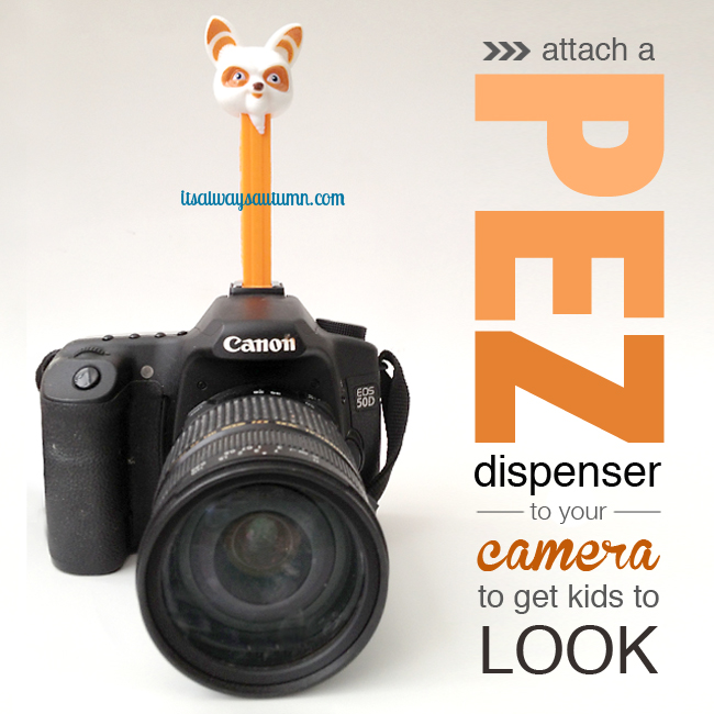Camera with pez dispenser on top to encourage kids to look