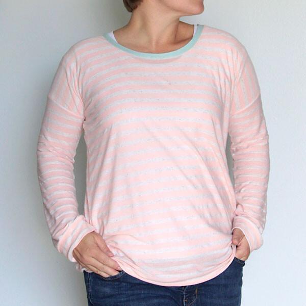A woman wearing a long sleeve t-shirt
