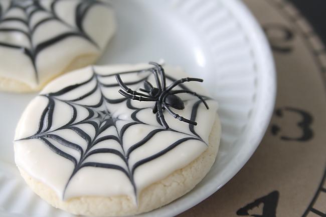 Spiderweb sugar cookie with plastic spider