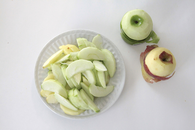 Apples peeled and sliced on a plate